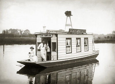 Henry Taunt and lady aboard their new houseboat c.1886, reproduced by permission of Pxfordshire County Council OCL3